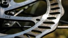 Macro Mondays - Olympics (that Geoff...) Tags: 70d hz bicycle biking brake canon cycling disc grass macro macromondays mondays mountainbike olympics rotor spokes wheel