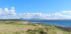 Torridon Mountains, from Big Sands near Gairloch, Wester Ross, August 2016 (allanmaciver) Tags: big sands wester ross west coast highlands torridon mountains clouds blue sky croft sea grass fence walk end road allanmaciver