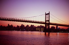 autumn sunset. (Vitaliy P.) Tags: new york city nyc bridge autumn sunset red orange reflection film colors analog 35mm river 50mm lights nikon fuji purple f14 scan east iso queens negative velvia epson fujifilm gothamist 100 v600 fm10 ais bk rfk unedited triboro unprocessed triborough vitaliyp