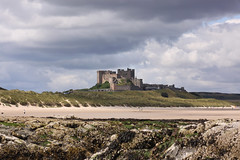 The clouds, the castle and the beach (Wilamoyo) Tags: england sky building castle english beach beauty weather stone architecture clouds composition coast sand ancient scenery view northumberland historical northeast bamburgh fortress depth