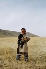 Nomadic Kid (dorjejyal) Tags: smile lamb amdo grassland    qinghai  zeku nomadickid tibetanrobe huangnanprefecture    huangnantibetanautonomousprefecture huangnan     ningxiu zekucounty   ningxiutownship