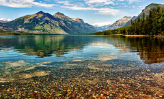 Pebbles in the Lake (Jeff Clow) Tags: lake mountains nature water landscape bravo rocks pebbles glaciernationalpark lakemcdonald tpslandscape