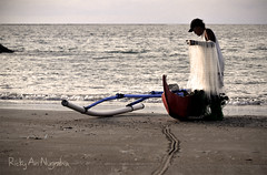 I Go Alone Because I Have To (Ricky Nugraha) Tags: sunset bali beach boat airport fisherman flickr traditional rai pantai segara bandara ngurah