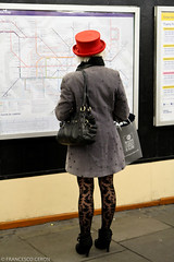 Red hat is searching the right train (Francesco | Ceron) Tags: red woman london hat vertical legs map tube viaggi londra vacanza efs1755mmf28isusm