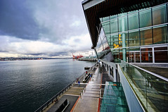 Vancouver Convention Centre in Winter (TOTORORO.RORO) Tags: street travel winter light sky canada cold reflection tourism water colors skyline architecture vancouver clouds buildings reflections shopping lens living downtown cityscape bc view zoom britishcolumbia sony wideangle center tourist exhibition metropolis alpha popular visitor canadaplace f4 hdr attractions vancouverharbour oss nex greatervancouver vancouverconventioncentre mirrorless 1018mm nex6 sel1018
