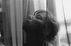 (Luca Tabarrini) Tags: portrait bw italy woman film girl beauty silhouette analog darkroom 35mm print blackwhite mujer chica femme indoor tent fabric analogue canonae1 sole ritratto biancoenero ragazza ilfordhp5plus pellicola stampa analogico cameraoscura ilfordpaper homeprint canonfd5018 lucatabarrini naiketyler