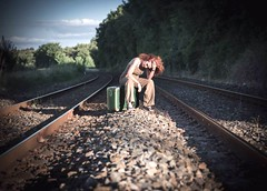 Off the rails... (Itinerrance) Tags: life people woman color lines train solitude human rails suitcase allocates