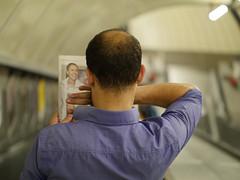 Ennis Hand (Magic Pea) Tags: streetphotography street candid unposed photo photography magicpea london urban man reading newspaper jessicaennis escalator tube underground