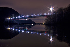 IMG_0548 (stars & rockets) Tags: longexposure bridge trees winter light newyork seascape mountains color reflection water night canon landscape lights bearmountain hudsonriver orangecounty starburst rocklandcounty bearmountainbridge fortmontgomery rebelt2i aliperretz