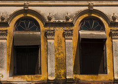 Two Windows Of An Old House With Decrepit Wall, Pondicherry, India (Eric Lafforgue) Tags: windows india colour yellow architecture outside outdoors day nobody nopeople dirty oldhouse thepast pondicherry pondichry carvedwall puducherry decrepitwall unionterritoryofpondicherry a0702254