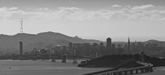 San Francisco, Sutro Tower, Bay Bridge and the Pyramid (NeilBerg79) Tags: ocean sf sanfrancisco city bridge sea blackandwhite bw tower clouds cityscape skyscrapers pyramid thecity bridges telephoto bayarea sutro transamerica distance