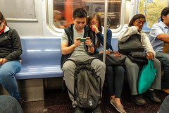 Phone focused (rockerlan) Tags: nyc people train subway phone manhattan sony transportation nework rx100