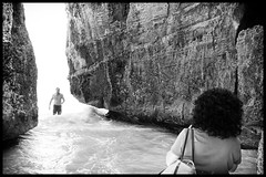 Between a rock... (mkc609) Tags: street blackandwhite bw beach blackwhite rocks candid canon20d streetphotography swimmer cancun