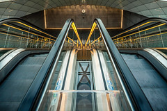 Triangeln South Entrance Escalators (Mabry Campbell) Tags: light clock lines station architecture photography photo skne europe december sweden interior escalator down tags photograph commercial trainstation 400 transportation 24mm escalators scandinavia malm malmo 2012 f63 tiltshift leadinglines level1 skane triangeln fav10 southernsweden southsweden sweco khras khr tse24mmf35l sec triangelnstation swecoarchitectsab mabrycampbell december222012 triagelnstation nillejuulsrensen 201212221325