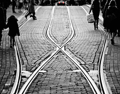 Crossroads (Allard Schager) Tags: road street city winter people urban blackandwhite bw holland classic netherlands monochrome lines amsterdam metal silver way lights vanishingpoint nikon downtown raw dof graphic patterns fineart january tracks nederland silhouettes tram symmetry rails pedestrians nik innercity dots timeless stad januari gettyimages graphical railtracks zw leidsestraat tramtracks voetgangers grafisch leadinglines selectivecolouring champagneflutes 2013 d700 nikond700 nikonfx nikkor70200mmf28vrii fullframepower efextail