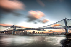 Manhattan Bridge (Tim Drivas) Tags: nyc newyorkcity longexposure bridge sunset skyline brooklyn clouds canon manhattan dumbo manhattanbridge eastriver gothamist hdr ndfilter brooklynbridgepark cloudmovement 9stop
