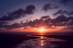 Westhaven Sunset (Ursa Davis) Tags: ocean blue sunset orange sun west beach water yellow set clouds landscape photography photo washington colorful purple pacific northwest united north photograph states davis ursa