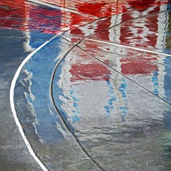 collision with red (weltreisender2000) Tags: concrete pavement wet reflection red barn door blue wall childrens play zoo atlanta abstract