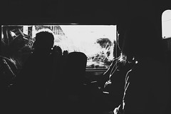 (jean_pichot1) Tags: sitting commute passengers people backlight backlit sunset bw scratch bright sunlight window tram