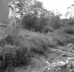 """Yours truly taking aim with a glass soda bottle at the """"glass breaking rock"""" in the """"swamp canal"""" by the Pumping Station.  (we had our own terms for everything). If you wanted to smash a bottle, this was the place to do it! Milford Connecticut. July 1973 (wavz13) Tags: oldphotographs oldphotos 1970sphotographs 1970sphotos oldphotography 1970sphotography vintagesnapshots oldsnapshots vintagephotographs vintagephotos vintagephotography filmphotos filmphotography vintagemilford oldmilford 1970smilford vintagewoodmont oldwoodmont 1970swoodmont connecticutphotographs connecticutphotos oldconnecticutphotography oldconnecticutphotos oldconnecticut vintageconnecticut connecticutphotography vintagenewengland oldnewengland 1970snewengland vintagenewenglandphotography oldnewenglandphotography vintagenewenglandphotos oldnewenglandphotos oldfamilyphotos vintagefamilyphotos oldfamilyphotography vintagefamilyphotography 126 126film squareformat instamatic verichromepan grain grainy vintagekids vintagechildren vintageteens vintageteenagers teenmemories teenagememories vintageteenboys vintageteenageboys vintageclothes oldclothes vintageclothing oldclothing instamatic104 kodakinstamatic104 1970sclothes 1970sclothing swamp swampy swamps wildflowers"""