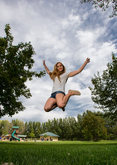 Fly, flew, flown (Flickr_Rick) Tags: jump jumping jumpology outside summer woman girl blond legs clouds trees breanne