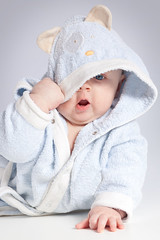 portrait of a cheerful child in blue bathrobe (Phooto!) Tags: baby child cute caucasian funny bathrobe people white portrait person one only little childhood boy babies toddler face eyes studioshot expression happy infant innocence blue human smiling cheerful beautiful happiness smile closeup healthy young playful positive emotions