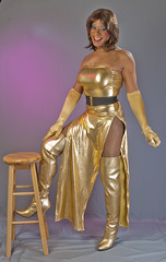 Gleaming In Gold! (kaceycd) Tags: crossdress tg tgirl lycra spandex gown dress tubedress longdress pantyhose fishnethose gloves operagloves highheels stilettoheels boots sexyboots kinkyboots vinyl stilettoboots thighboots stilettos s