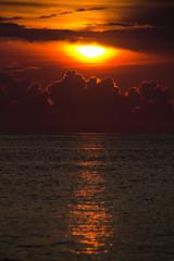 Frozen in Time (Blepfo) Tags: ocean morning light sunset red sky orange cloud sunrise landscape photo time scene atlantic outer banks blepfo