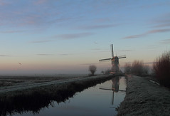 Vlist (Pepijn Hof) Tags: morning winter light sky mist holland colour tree bird mill nature water windmill dutch field fog sunrise canon landscape licht horizon nederland natuur 7d fields polder 1740mm breathtaking vogel ochtend landschap zuidholland reflectie spiegeling vlist