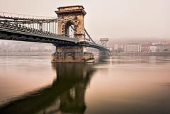 Budapest - Chain Bridge Atmosphere (Nomadic Vision Photography) Tags: winter misty moody budapest ambient danube chainbridge centraleurope jonreid bridgearchitecture tinareid budapestlandmark nomadicvisioncom theszchenyichainbridge budapestattraction