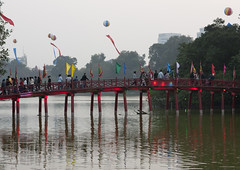 Huc Bridge On Hoan Kiem Lake, Hanoi, Vietnam (Eric Lafforgue) Tags: bridge red people lake building water horizontal architecture standing person wooden asia exterior capital crowd fulllength landmark flags vietnam hanoi groupofpeople humanbeing colorphoto hoankiemlake hoguom pennants capitalcity hucbridge reddao swordlake reddzao lakeoftherestoredsword daopeople lakeofthereturnedsword groupofpersons hanoicity vietnam8517