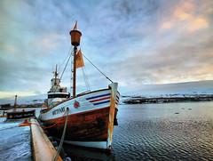 Ship at the Dock in Akureyri, Iceland (` Toshio ') Tags: sunset sky water clouds bay harbor pier boat iceland dock europe european ship ripple fjord mast akureyri icelandic toshio