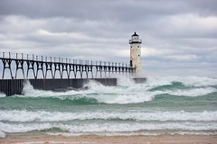 Manistee Breakwater Lighthouse Manistee, Michigan (Michigan Nut) Tags: sky usa lighthouse storm beach nature clouds landscape pier midwest waves michigan scenic landmark lakemichigan greatlakes coastline draco johnmccormick manisteelighthouse michigannutphotography stormdraco