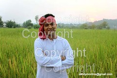 Indian Farmer (picsrover) Tags: sunset sky people sun white flower nature field grass smiling horizontal closeup standing sunrise outdoors photography holding hands day adult paddy content happiness growth desi crop mustard maharashtra farmer turban agriculture sideview ricefield adultsonly folding oneperson freshness villager kurta headandshoulders bihar bandhani uttarpradesh midadult traditionalclothing northindian maharashtrian ruralscene onlymen onemanonly colourimage differentialfocus onemidadultmanonly bhojpuri midadultmen indianethnicity traditionallyindian gamchha 3039years gamaja