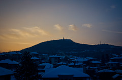 Monastery above the city (Aleks G. Photography) Tags: city sunset mountain snow clouds view roofs monastery