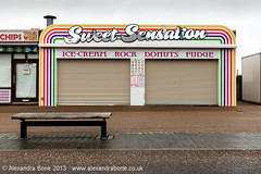 Sweet Sensation (Alexandra Bone Photography) Tags: winter beach wet bench out season town marine photographer sweet south great norfolk parade alexandra norwich bone arcades yarmouth amusements abandonment sensation denes alexandrabonephotography wwwalexandrabonecouk