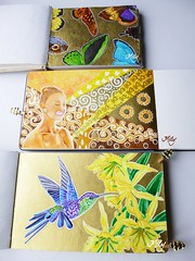 My 3 Golden Journals (Milagritos9) Tags: gold wings artwork transformation handmade drawing patterns mariposas treeoflife oro birdportrait artistjournal milagritos butterflyart birdillustration womanportrait mysticart illustratedjournal goldbird moleskinejournals flowerspainting 21122012 artmoleskine butterflyjournal butterflyillustration birdjournal inspirationaljournal flordeamancaes milycha diarioilustrado pájaroillustración spiritualjournal colibriart moleskineartpages moleskinewatercolours moleskinehandmade moleskinepaintings pinturapicaflor cuadernoillustrado zintagle amancaesflowers
