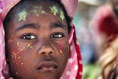 Child at Womad 2012 (Sallyrango) Tags: portrait face festival candid womad paintedface worldmusicfestival childsface candidchild candidkid womaduk womad2012