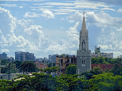 San Juan, Puerto Rico (brucecarlson66) Tags: blue roof red sky cloud sun building tree green beautiful beauty architecture forest tile de puerto outside san catholic power apartment cross juan outdoor masonry over line rico jorge tropical environment rise simple bautista glesia