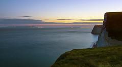 nightfall over Dorset cliffs and Jurassic Coast (colour version) (lunaryuna) Tags: uk england dorset coastcoastline cliffs chalkcliffs buffs jurassiccoast lulworth sea nightfall dusk citylights weymouthatthehorizon ship le longexposure water lightmood lunaryuna