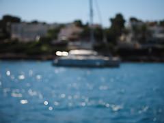 Fata Morgana (Vintage lens lover) Tags: water sea meer boot katamaran sommer balearen sonne mallorca