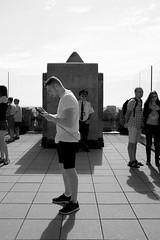 Selfie Checking At The Top Of The Rock (andyfpp) Tags: fuji fujifilm x100t newyork nyc newyorkcity blackandwhite bw bwred mono monochrome monotone selfie stick iphone rock topoftherock shadows rockefeller