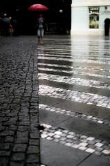 Umbrella Parade 3 (tomabenz) Tags: sony a7rm2 urban praha prague umbrella czechrepublic streetview human geometry europe praga street photography humaningeometry sonya7rm2 streetphotography red bokeh