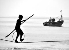 101204 Balancing jn Front of the Sea (BavarIndia) Tags: asia tika