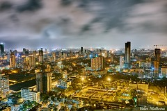 Northwards Mumbai (Vidur Malhotra) Tags: southmumbai mumbai india night citylights longexposure golden building