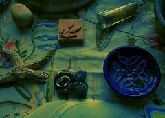moodygreen (LauraSorrells) Tags: blue green home glass stone this bottle moody starfish feather altar clay tiny artifact stillness boneyard incense thecove 2011 beautyinthemundane