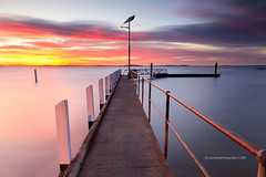 Divided (SoniaMphotography) Tags: morning travel pink holiday sunrise canon dawn pier jetty australia roadtrip victoria line wharf serene phillipisland cowes rhyll