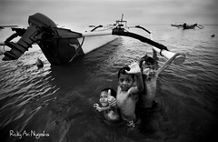 The Playground for Fisherman's Child (Ricky Nugraha) Tags: bali segara fisherman nelayan boat kids anak pesisir pantai beach kuta airport