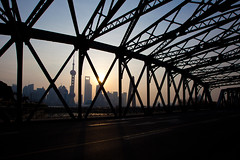 Waibaidu bridge at Sunrise in Shanghai. (Eason Q) Tags: china city sky tower silhouette horizontal architecture sunrise outdoors photography shanghai fulllength citylife connection oneperson thebund orientalpearltower traveldestinations colorimage waibaidubridge buildingexterior constructionframe pudonghuangpuriver shanghaiskyscraperadult gettychina13q1