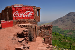 Atlas coke (Thomas Roland) Tags: city travel blue red mountain holiday mountains green berg landscape high village cola outdoor valle dal coke tourist advertisement morocco berber valley maroc atlas marrakech marrakesh colourful rd landschaft coca contrasts ville marokko quantum ourika landskab turist entanglement bjerg lourika